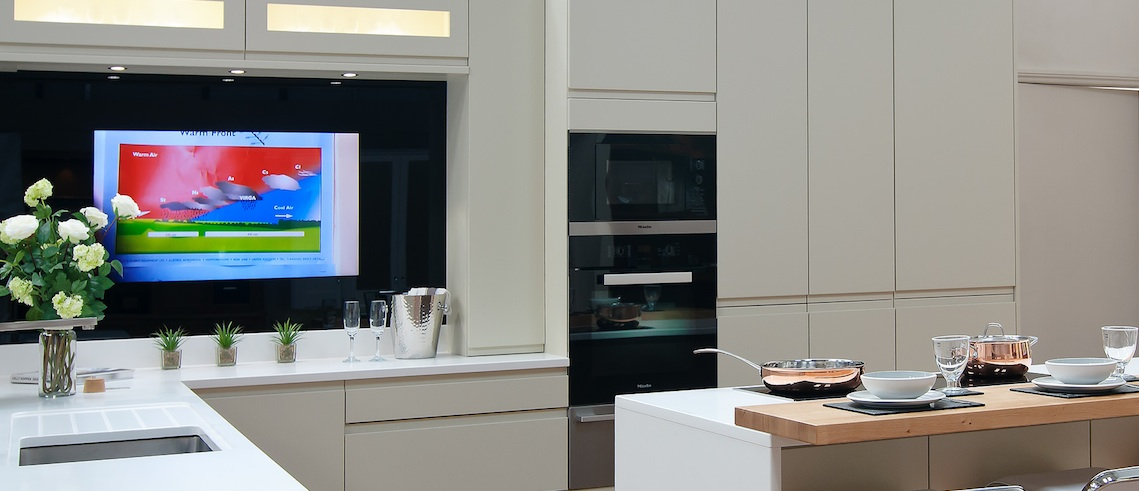 Kitchen design with television splash back